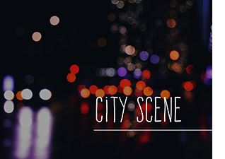 City Scene text over image of blurry street at night